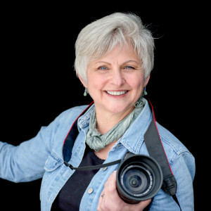 Photo of Rebecca Benoit holding a camera