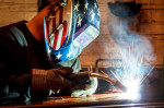 Welder with American flag helmet